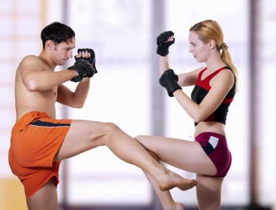 healthy and fit man and woman boxing