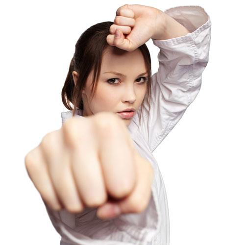 fit girl punching karate